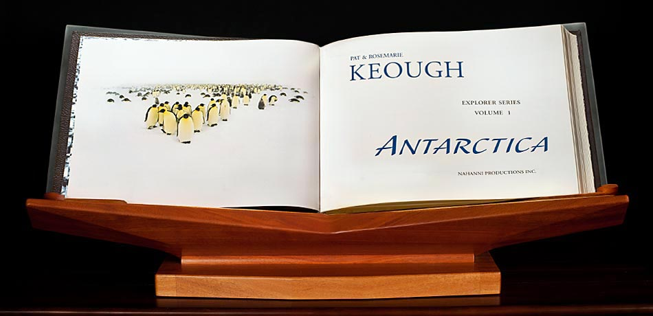 Title page of ANTARCTICA showing photo of Emperor Penguin in a Bizzard