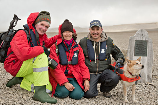 Pat and Rosemarie Keough with Pascal Lee, Planetary Scientist with the SETI Institute and NASA. And with King Kong, polar bear dog. Beechey Island, Franklin Graves.
