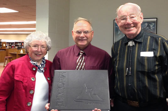 Jack and Phyllis Kalivoda with Dan Knock head librarian at Hillsdale College, Michigan, receiving donation of ANTARCTICA, the tome by Pat and Rosemarie Keough