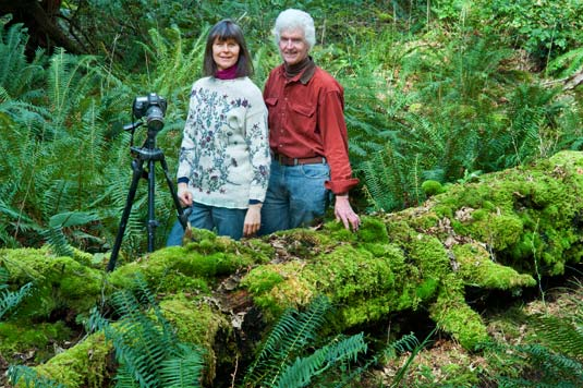 Pat and Rosemarie Keough and moss covered nurse log